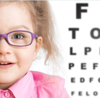 Picture of little girl with eye chart behind her