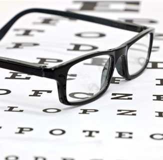 Picture of a pair of glasses on an eye chart